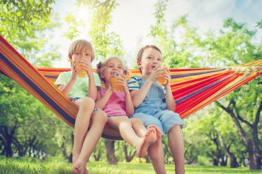 Three children in a hammock.